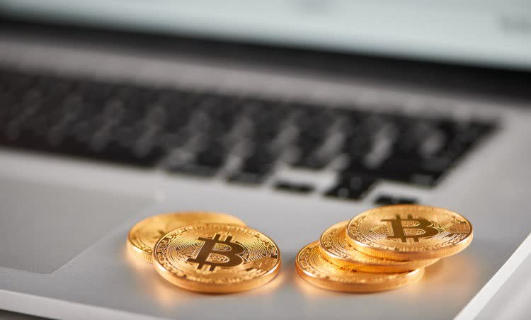 Golden Bitcoins are on the laptop